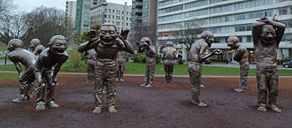 A-maze-ing Laughter by Yue Minjun in Vancouver
